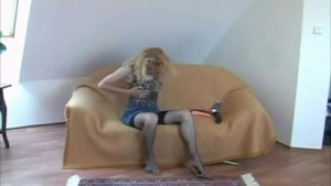 Grim blonde with curly hair is getting fucked in front of the camera, while fingering her pussy